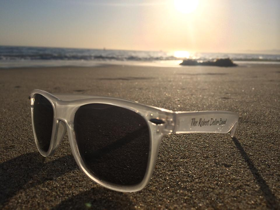Sunglasses On Sand  deller band clear sunglasses in the sand