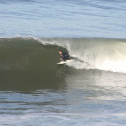 Travis Coco catching a cool wave