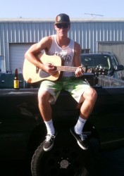"Travis Coco, ""Just another day sittin' and playing guitar on my truck""..."